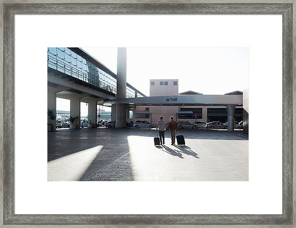 Two Gay Men Walking To Taxi Rank Framed Print