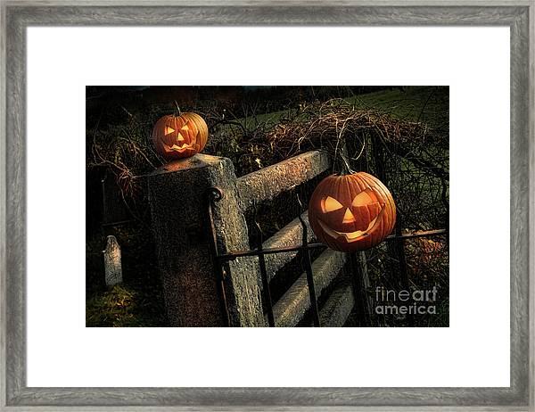 Two Halloween Pumpkins Sitting On Fence Framed Print