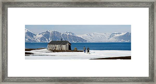 Two Hikers Standing On The Beach Framed Print