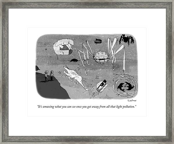Two Men Look Up At The Night Sky To See Framed Print