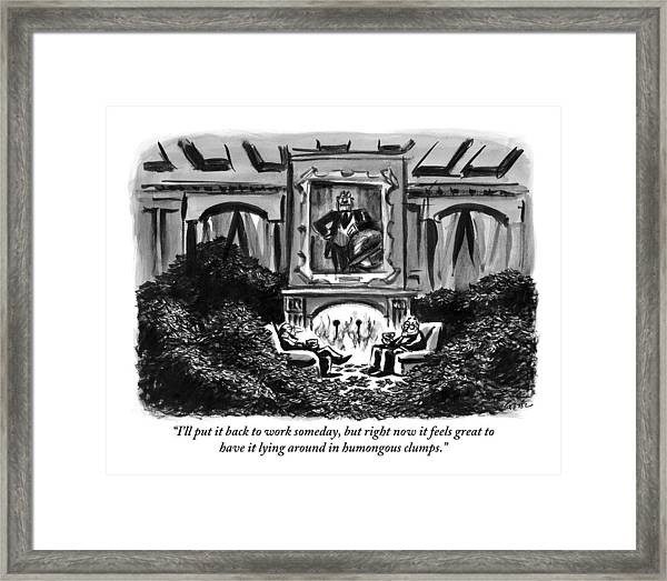 Two Men Sit Next To A Fireplace With Large Piles Framed Print
