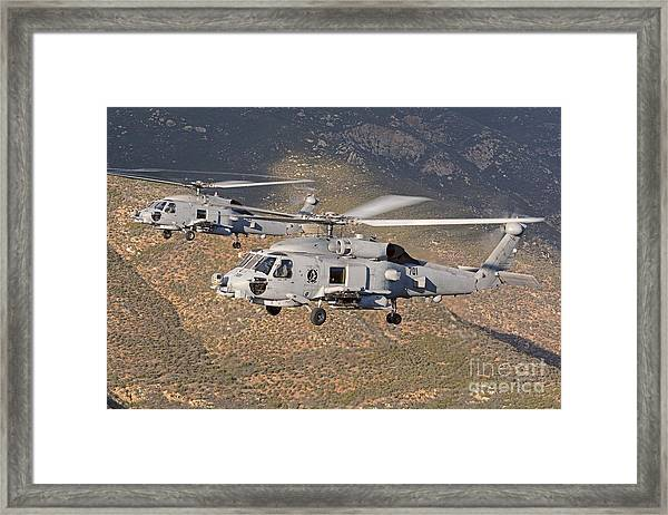 Two Mh-60 Helicopters Of The U.s. Navy Framed Print
