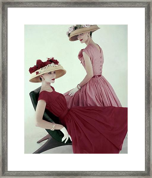 Two Models Wearing Red Dresses Framed Print
