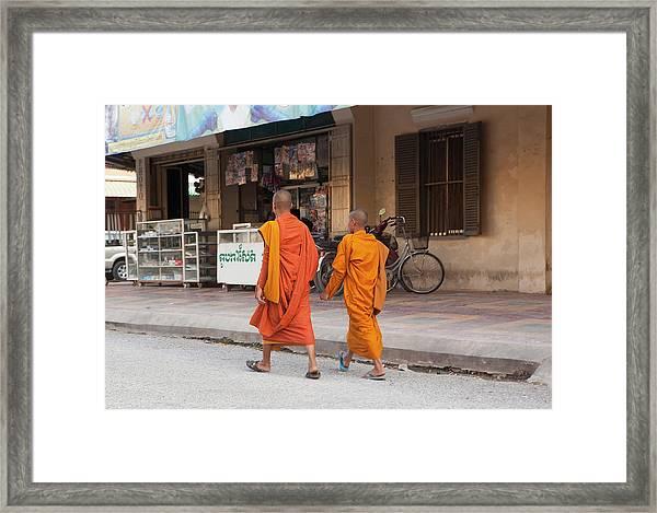 Two Monks In The Street In Battambang Framed Print