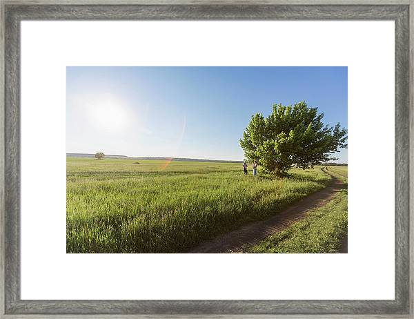 Two Mothers Holding Their Babies While Framed Print
