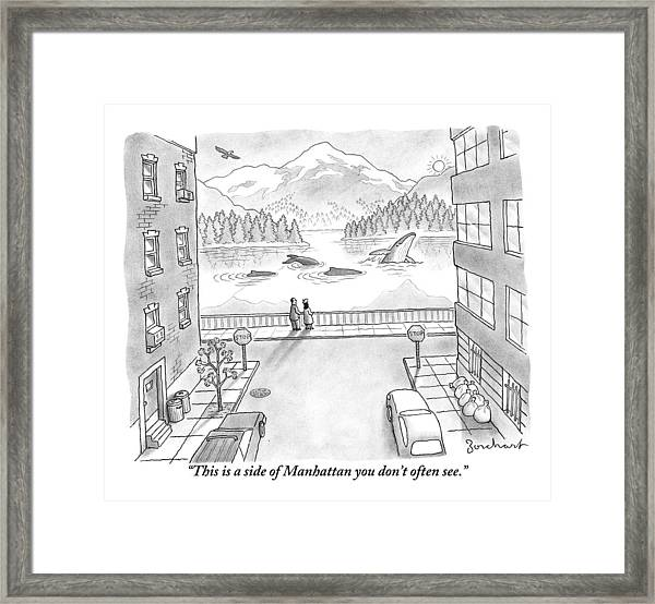 Two People In Manhattan Gaze Out At A Spectacular Framed Print