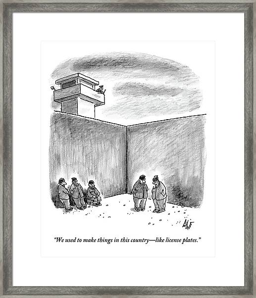 Two Prisoners Talk In The A Prison Yard Framed Print