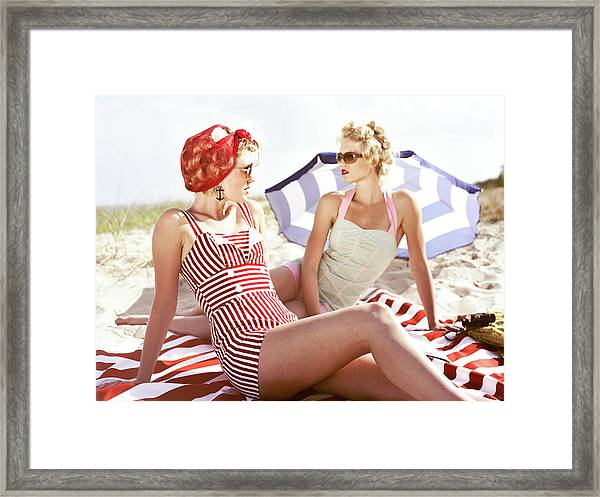 Two Retro Young Women On Beach Framed Print