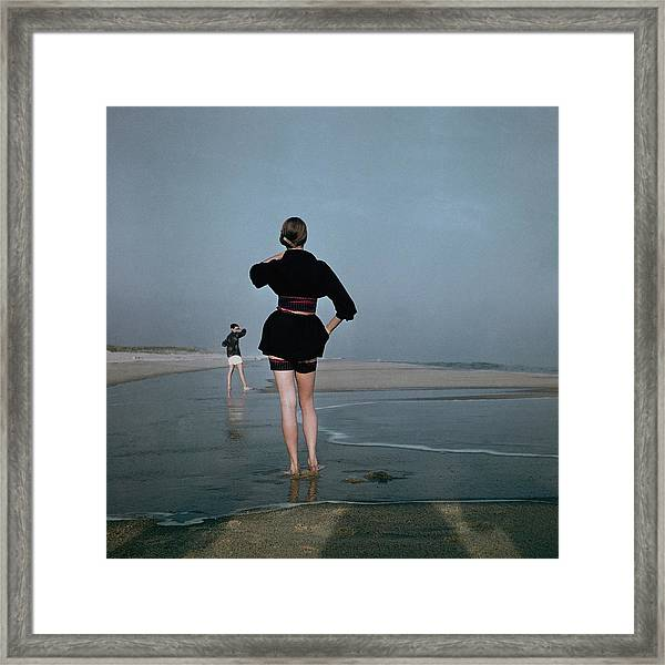 Two Women At A Beach Framed Print