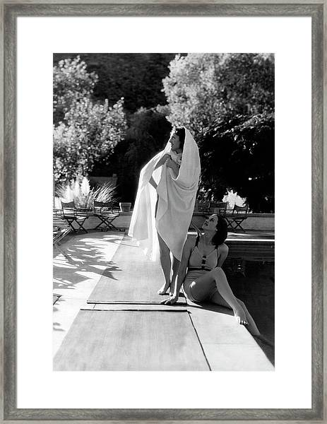 Two Women By A Swimming Pool Framed Print