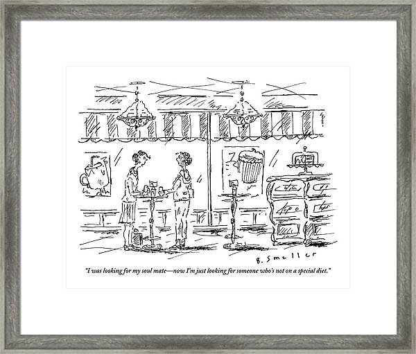 Two Women Stand At A Table In A Cafe Framed Print