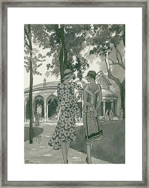 Two Women Walking In A Park Framed Print