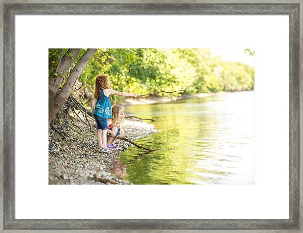 Two Young Girls Playing On Bank Of Mississippi River Framed Print by Emholk