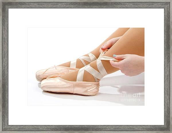 Tying Ballet Slippers Framed Print