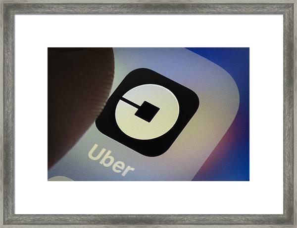 Uber App Framed Print by Thomas Trutschel