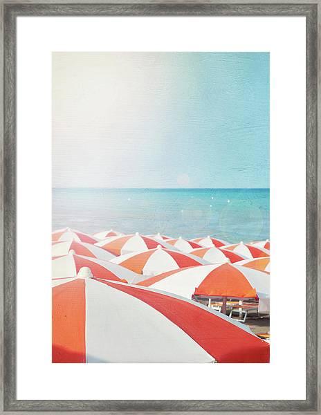 Umbrellas On Beach Framed Print