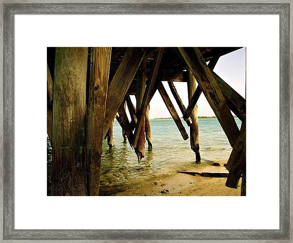 Under The Broke Dock Framed Print
