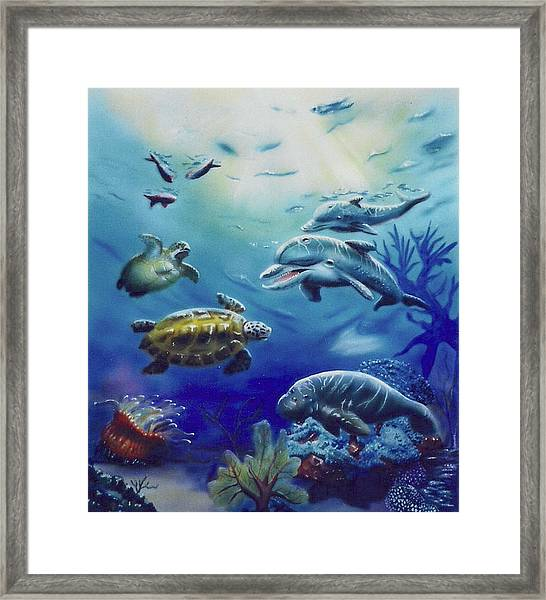 Under Water Antics Framed Print