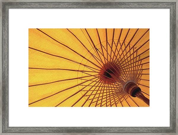 Underside Of Yellow Parasol, Symbol Of Framed Print by Antony Giblin