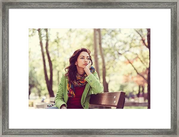 Unhappy Girl Sitting At Bench Framed Print by Martin Dimitrov