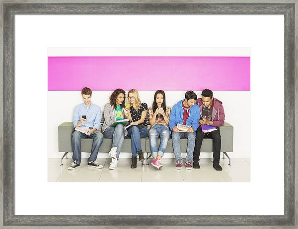 University Students Sitting On Bench Framed Print by Robert Daly
