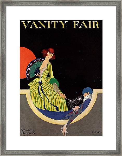 Vanity Fair Cover Featuring A Woman Holding Framed Print by Rita Senger