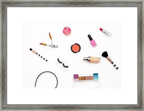 various makeup products and cosmetics in white background.Top view Framed Print by Carol Yepes