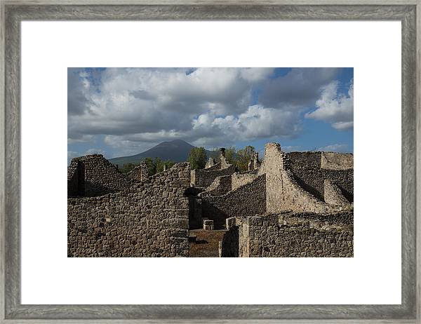 Vesuvius Towering Over The Pompeii Ruins Framed Print