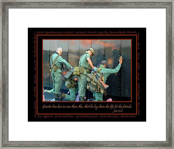 Veterans At Vietnam Wall Framed Print
