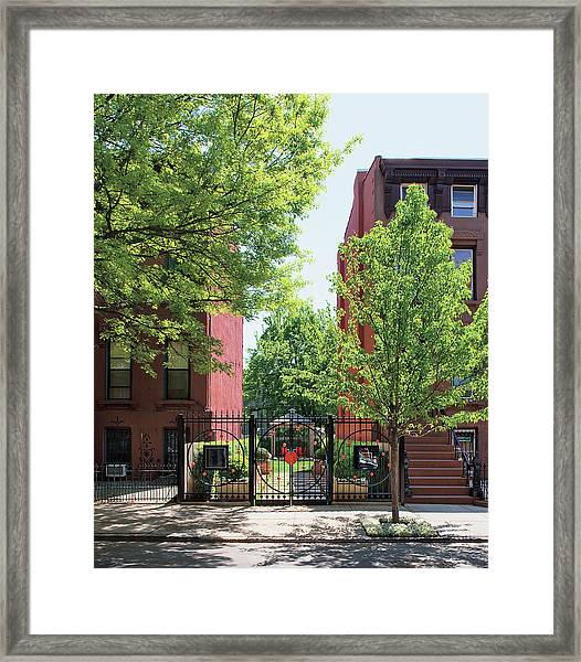 View Of Building And Garden With Closed Gate Framed Print