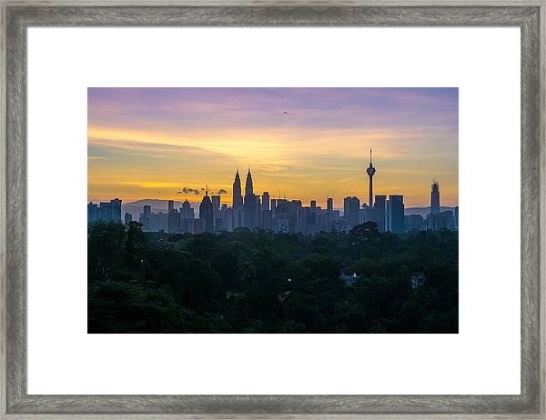 View Of Cityscape Against Sky During Sunset Framed Print by Shaifulzamri Masri / EyeEm