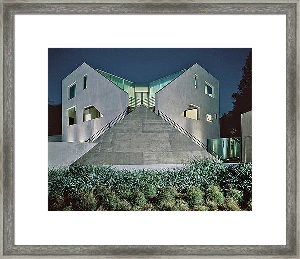 View Of Modern Building At Night Framed Print