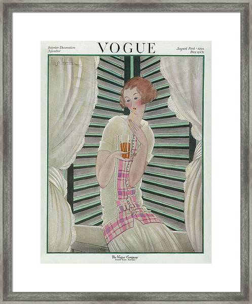 Vogue Cover Featuring A Woman Drinking Framed Print