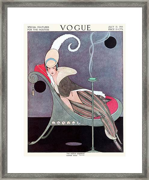 Vogue Cover Featuring A Woman Sitting In A Chair Framed Print by Helen Dryden