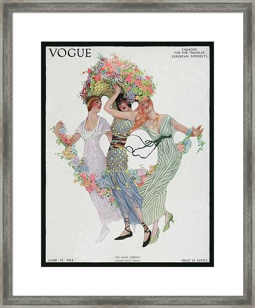 Vogue Cover Featuring Three Women With Flowers Framed Print
