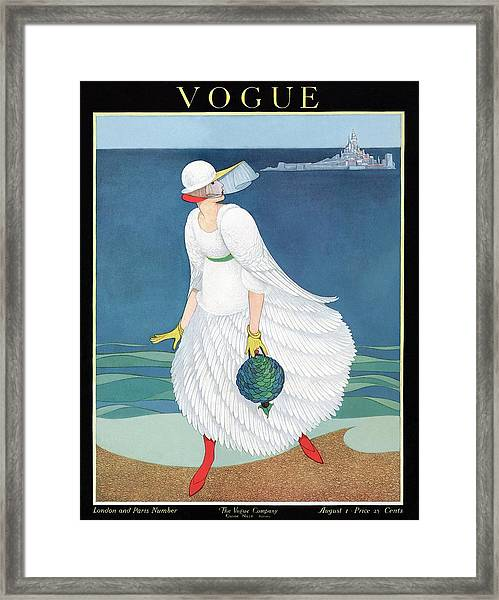 Vogue Cover Featuring Woman At A Beach Framed Print