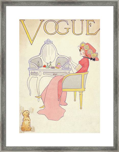 Vogue Cover Illustration Of A Woman Sitting Framed Print by Davis