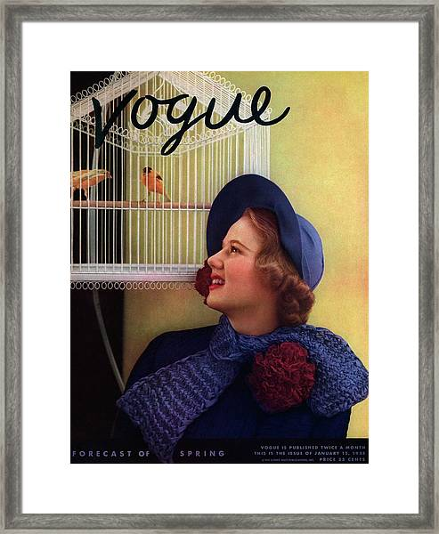 Vogue Cover Of Model Looking At Bird Cage Framed Print