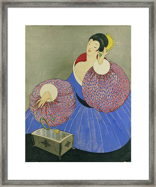Vogue Drawing Of A Woman Taking Off Her Jewelry Framed Print by George Wolfe Plank