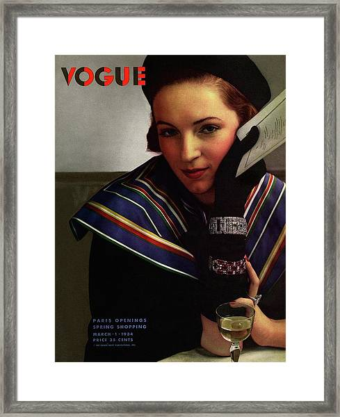 Vogue Magazine Cover Featuring A Model Wearing Framed Print