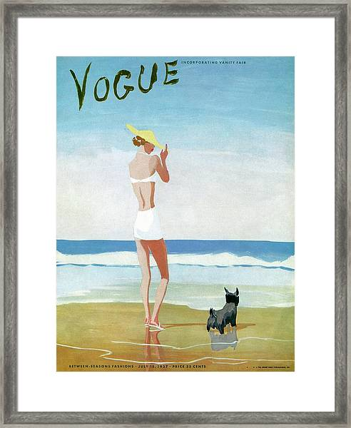 Vogue Magazine Cover Featuring A Woman On A Beach Framed Print