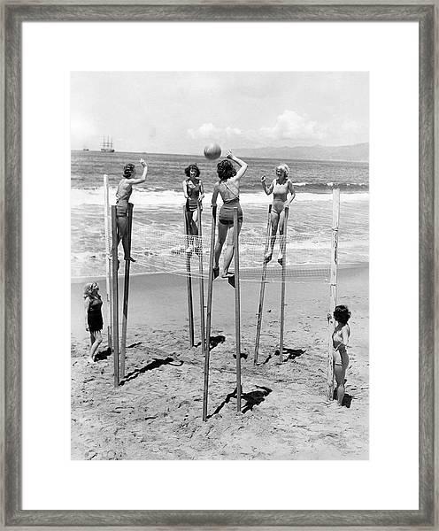 Volleyball On Stilts Framed Print