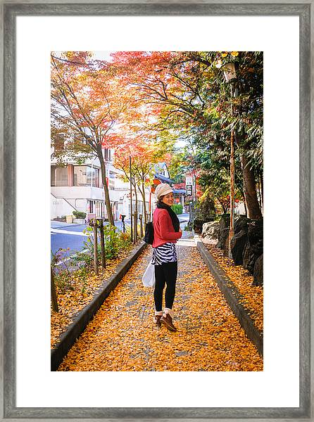 Walking On The Footpath With The Yellow Leaves Framed Print by Suphat Bhandharangsri Photography
