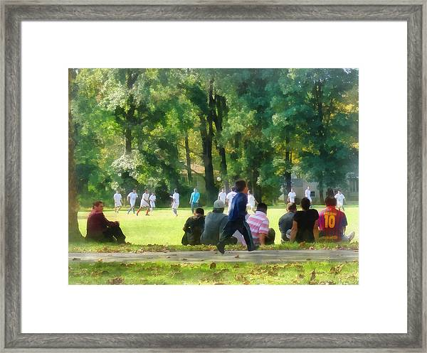 Watching The Soccer Game Framed Print