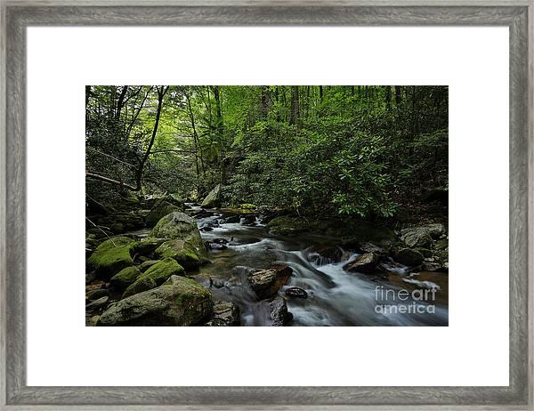 Water Falls And Rocks Framed Print by Mina Isaac