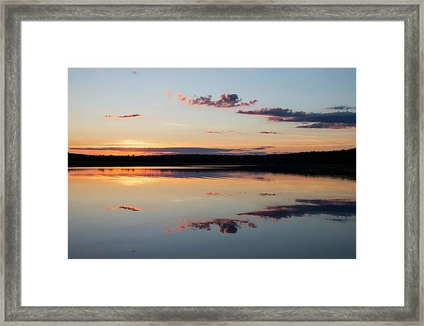 Water Mimics Sky As The Day Fades Framed Print