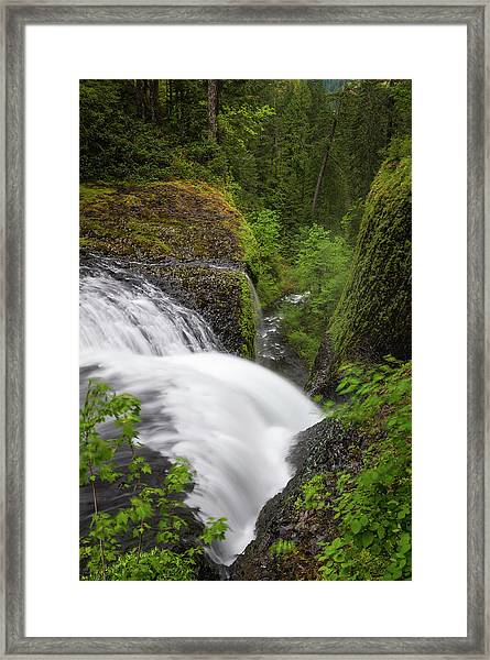 Waterfall Cascading Down Narrow Forest Framed Print
