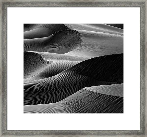 Waves In The Sand Framed Print