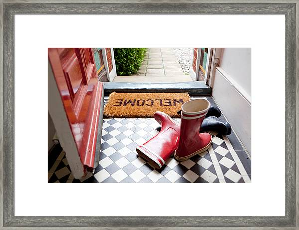 Welcome Mat And Wellington Boots Framed Print by Image Source