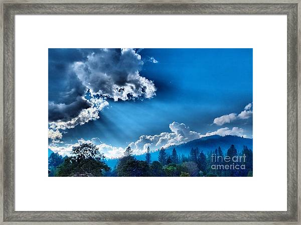 Westerly Clouds Framed Print